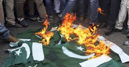 Pakistan flag is burnt by Pakistanis.