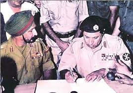 General Niazi , Pakistani general, is signing the surrender documents in 1971.