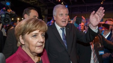 Top Merkel ally calls for asylum cap