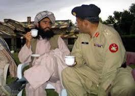 Talib is enjoying tea with Pakistan Army Personel