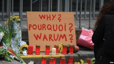 Belgians Ask: 'Why Us?'
