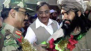 One Pakistan Army general and Brig. in white dress with the militants leader