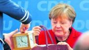 Merkel firm on her refugee
