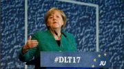 Angela Merkel plays down state election defeat